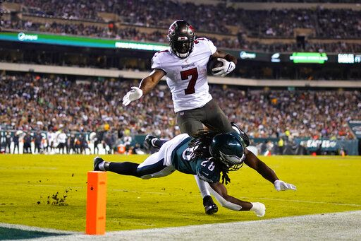Philadelphia Eagles quarterback Jalen Hurts (1) scores a goal ahead of Tampa Bay Buccaneers defender Dee Delaney (30) in the second half of an NFL football game in Philadelphia on Thursday, October 14, 2021.