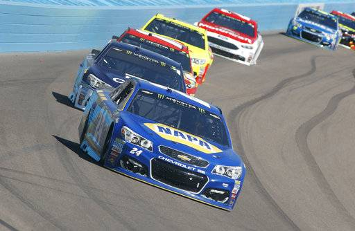 Chase Elliott (24) drives into Turn 1 during the NASCAR Cup Series auto race at Phoenix International Raceway, Sunday, March 19, 2017, in Avondale, Ariz.