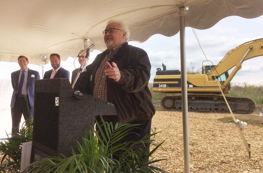 Vernon Hills Mayor Roger Byrne, right, speaks during a Friday ground breaking ceremony for Mellody Farm development in Vernon Hills.
