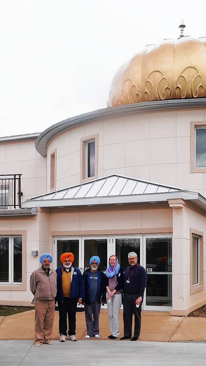 Sikh representatives with Palatine library staff outside the Sikh Gurdwara in Palatine.