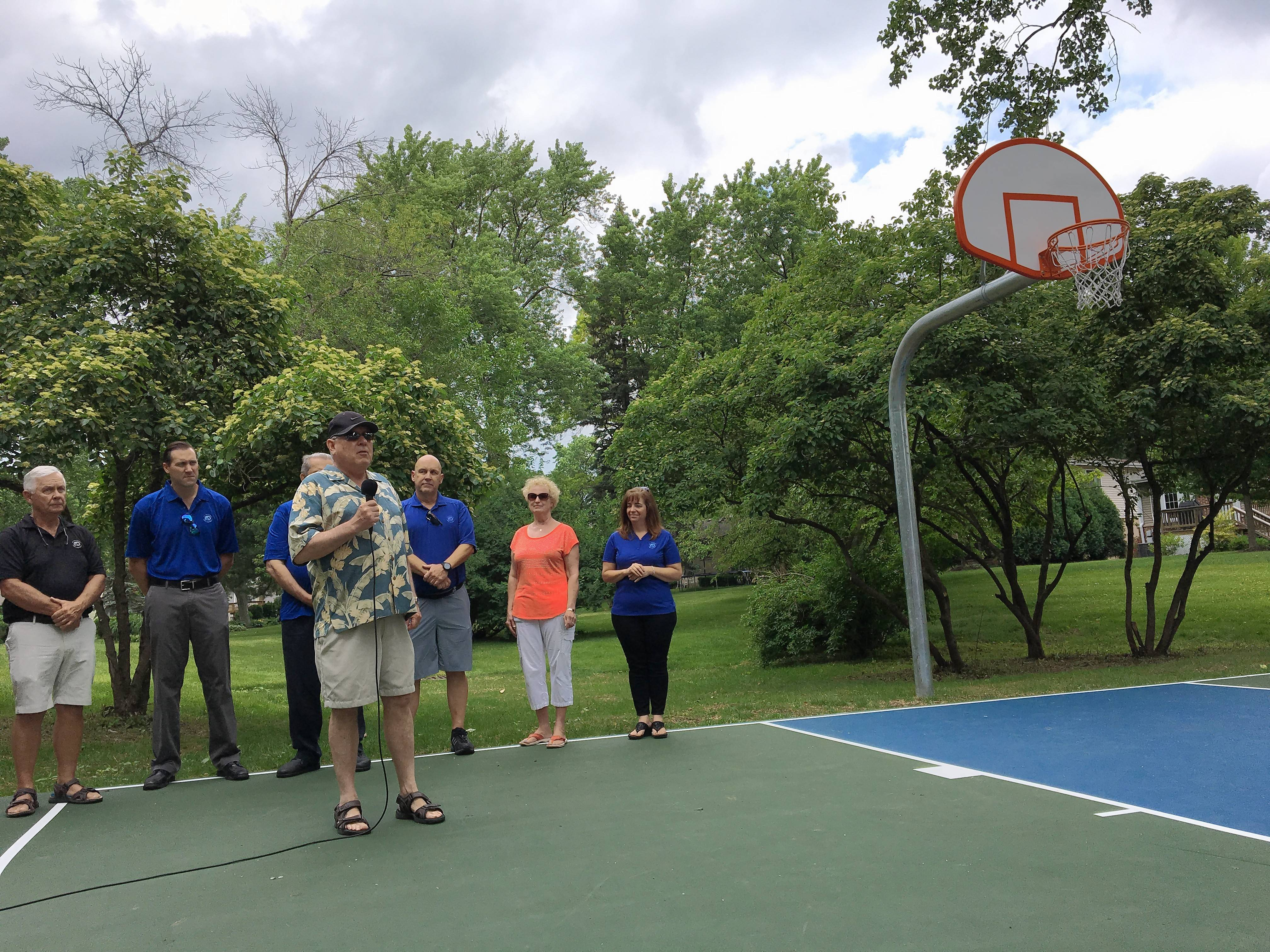 Bruce Gillilan of Mount Prospect speaks during a dedication Saturday of a basketball court in We-Go Park in memory of his daughter Lindsay, a special needs kindergarten teacher with Lake Zurich Unit District 95 who died suddenly of heart failure in 2009.