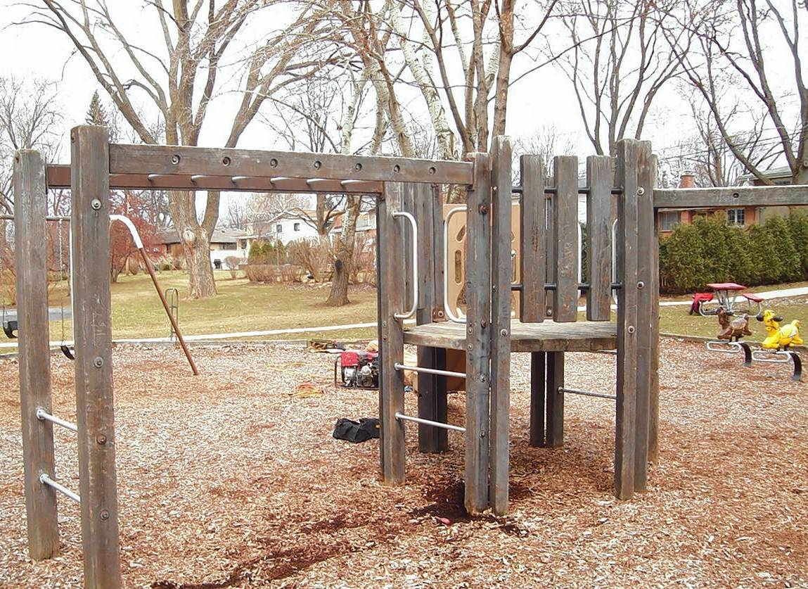 The aging wooden structures at We-Go Park Play Lot in Mount Prospect were removed last year and the park reopened Saturday with new playground equipment and a basketball court dedicated in honor of a former resident.