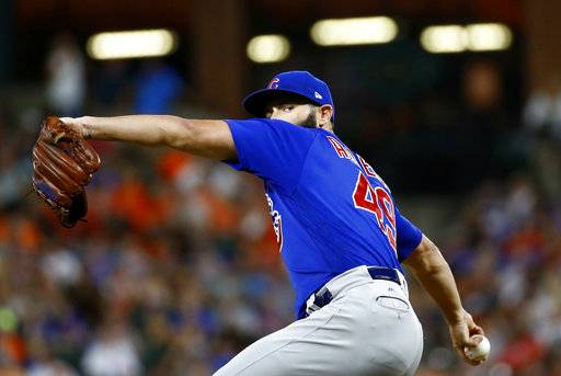 Chicago Cubs starting pitcher Jake Arrieta throws to the Baltimore Orioles in the fifth inning of a baseball game in Baltimore, Saturday, July 15, 2017.