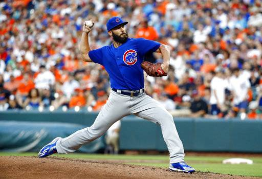 Chicago Cubs starting pitcher Jake Arrieta throws to the Baltimore Orioles in the second inning of a baseball game in Baltimore, Saturday, July 15, 2017.