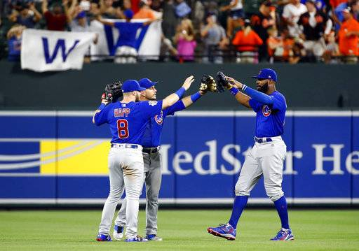 Chicago Cubs outfielders Ian Happ, Albert Almora Jr. and Jason Heyward celebrate after the team's baseball game against the Baltimore Orioles in Baltimore, Saturday, July 15, 2017. Chicago won 10-3.
