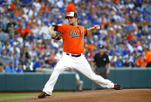 Baltimore Orioles starting pitcher Wade Miley throws to the Chicago Cubs in the first inning of a baseball game in Baltimore, Saturday, July 15, 2017.