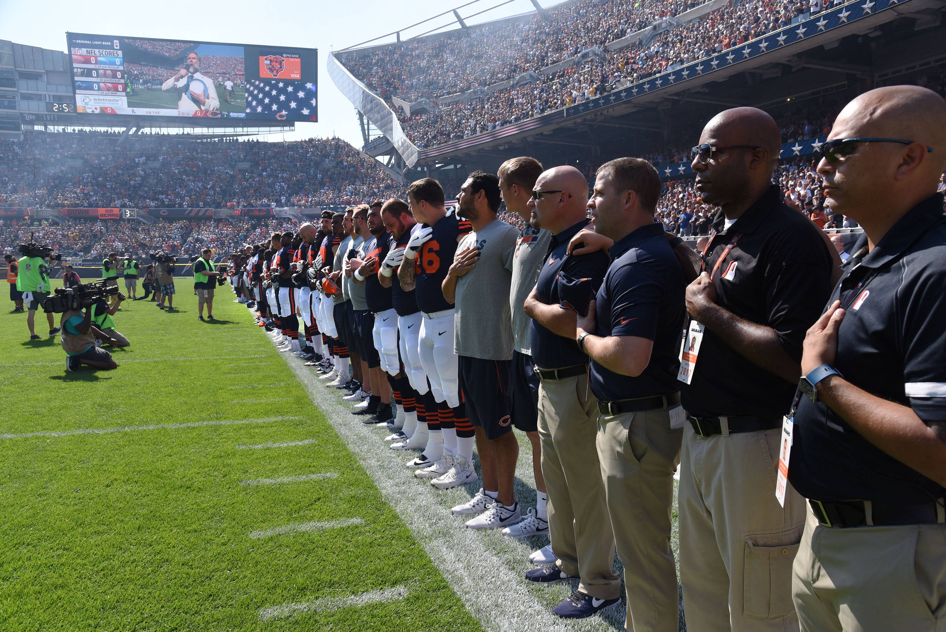 "The Chicago Bears locked arrms during the national anthem Sunday before their game against the Pittsburgh Steelers. ""We fought together,"" linebacker Danny Trevathan said, ""and I was proud of this team."""
