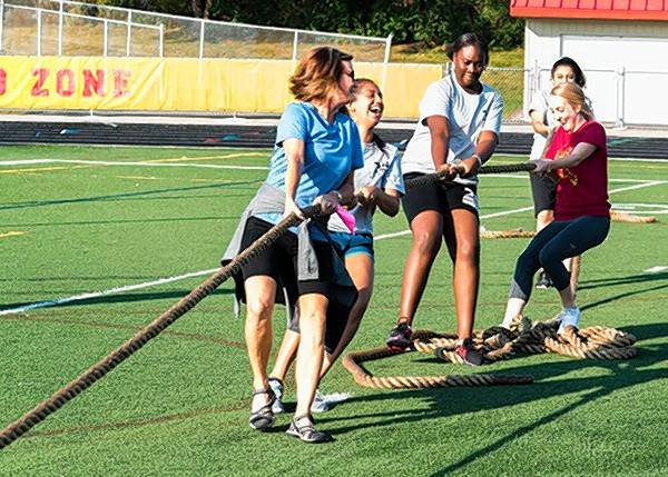 Students and teachers from Schaumburg High School participate in an obstacle course as part of the school's homecoming fundraising activities. Over the course of the week, students raised $2,000, which was donated to an elementary school in Katy, Texas.
