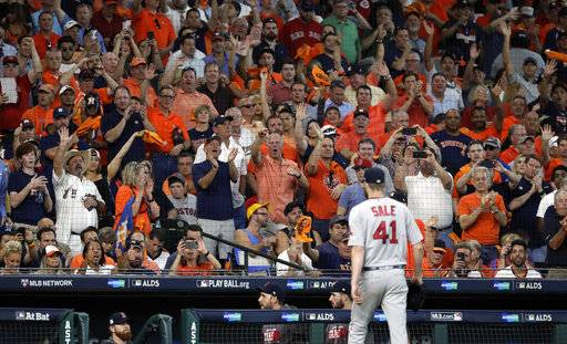 Fans react as Boston Red Sox starting pitcher Chris Sale (41) is pulled from the baseball game in the sixth inning in Game 1 against the Houston Astros on an American League Division Series, Thursday, Oct. 5, 2017, in Houston.
