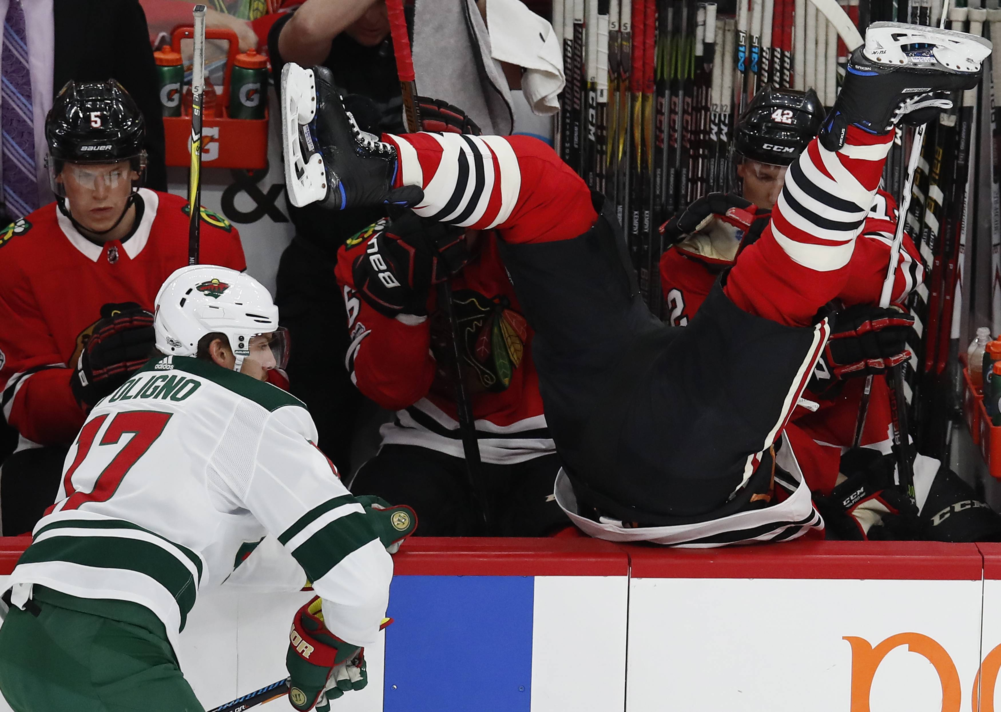 Chicago Blackhawks defenseman Brent Seabrook goes over the boards after getting checked by Minnesota's Marcus Foligno during the first period Thursday in Chicago.