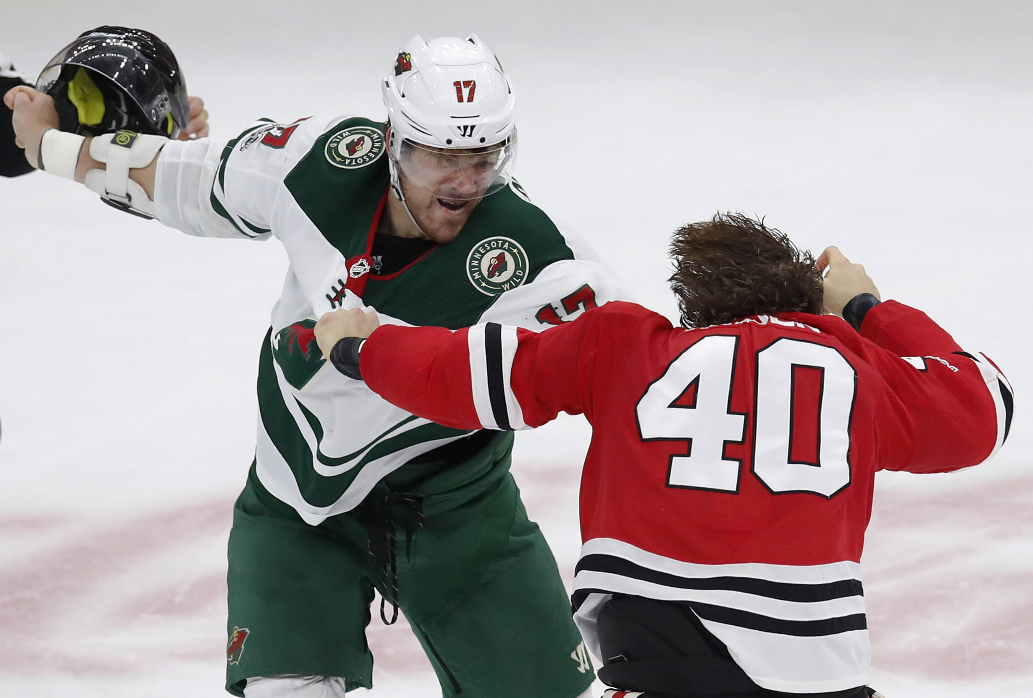 Minnesota Wild's Marcus Foligno, left, and Chicago Blackhawks' John Hayden squared off in the second period of Thursday's game in Chicago.