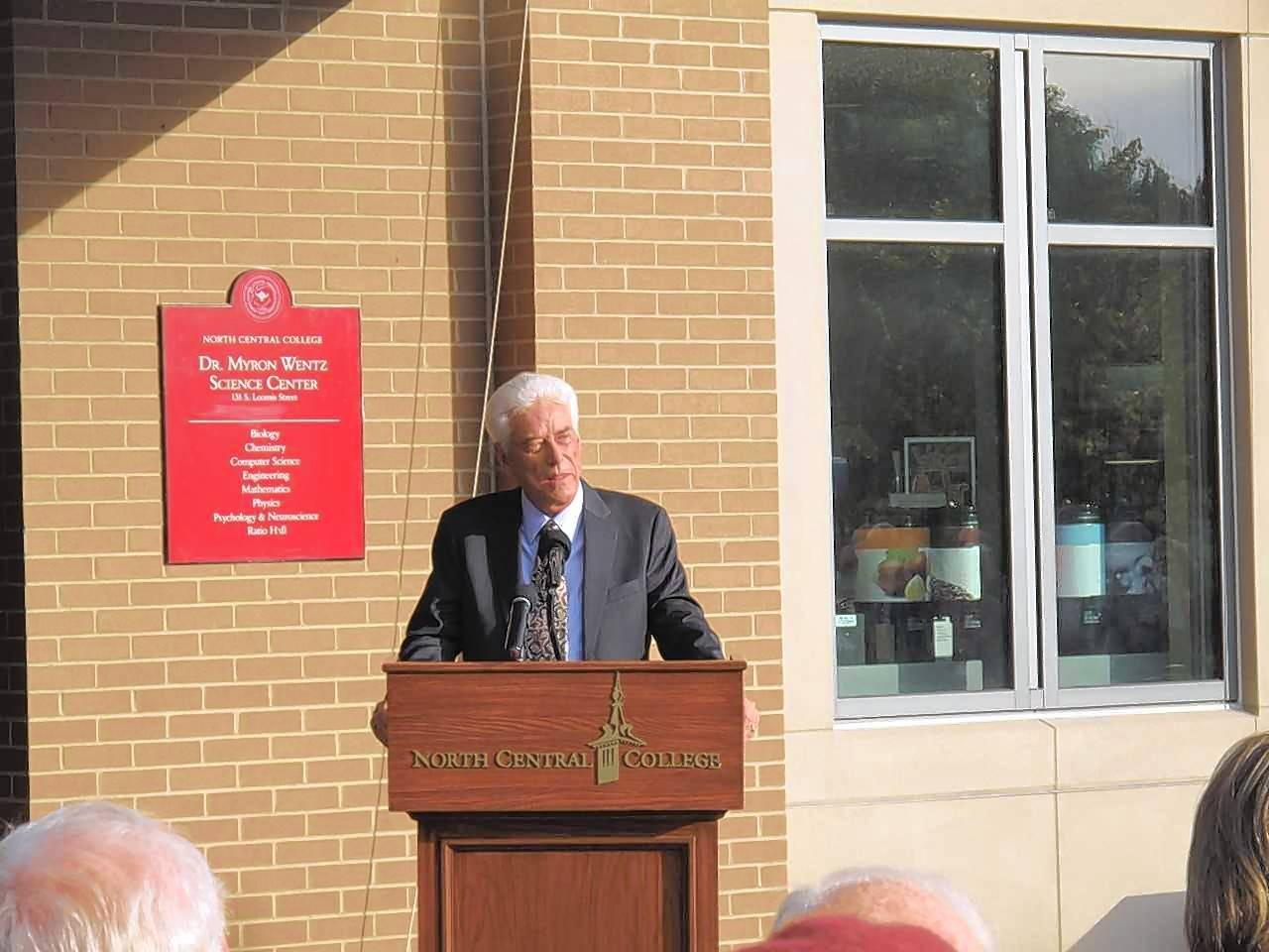 Scientist and North Central College alum Myron Wentz speaks Friday afternoon as the school in Naperville dedicates its $60 million science center in his name, recognizing his lead donation.