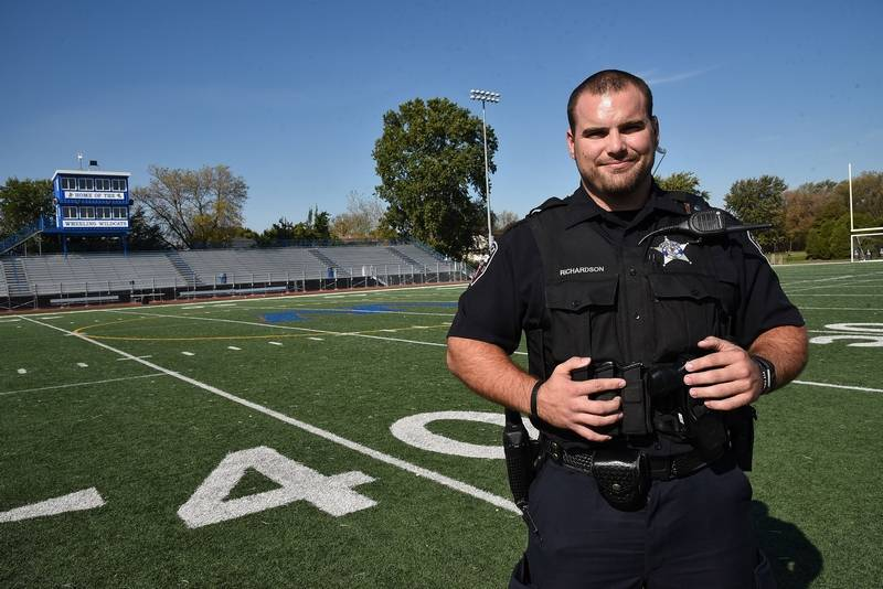 Wheeling cop helps save life of referee during football game