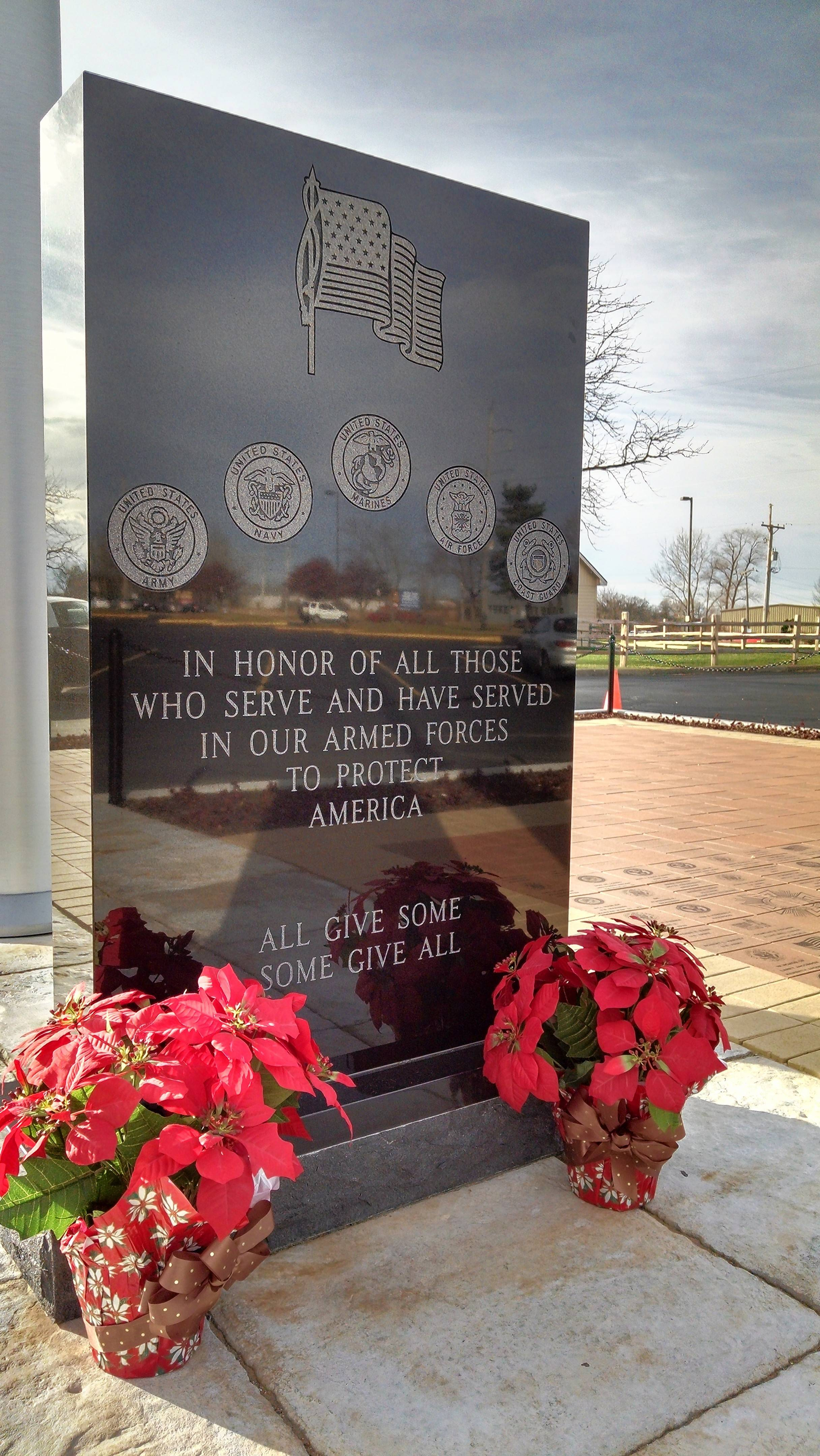 The Woodstock Harley-Davidson Veterans Memorial features a black granite engraved monument as the base of its 80-foot flagpole with a giant American flag. For Veterans Day Nov. 11, the dealership will host a Veterans Fair and ceremony.
