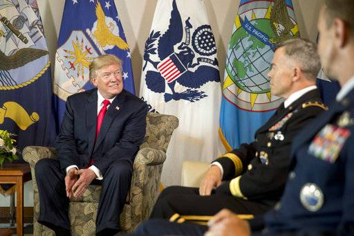 President Donald Trump attends a briefing at U.S. Pacific Command (PACOM), Friday, Nov. 3, 2017, in Aiea, Hawaii. Trump begins a 5 country trip through Asia traveling to Japan, South Korea, China, Vietnam and the Philippians.