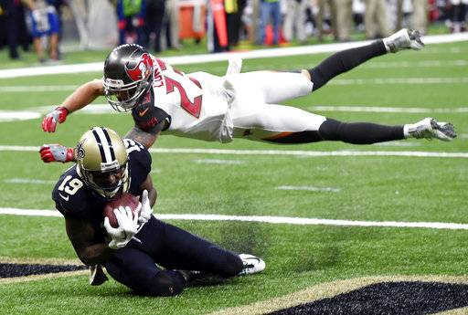 New Orleans Saints wide receiver Ted Ginn (19) pulls in a touchdown pass against Tampa Bay Buccaneers free safety Chris Conte (23) in the second half of an NFL football game in New Orleans, Sunday, Nov. 5, 2017.