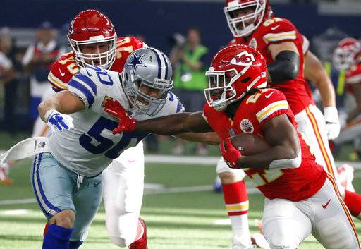 Dallas Cowboys linebacker Sean Lee (50) attempts to stop Kansas City Chiefs running back Kareem Hunt (27) in the first half of an NFL football game, Sunday, Nov. 5, 2017, in Arlington, Texas.