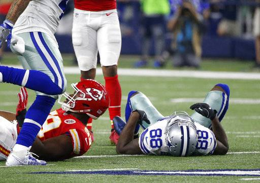Dallas Cowboys' Dez Bryant (88) lays on the field by Kansas City Chiefs' Reggie Ragland (59) after attempting to catch a pass in the second half of an NFL football game on Sunday, Nov. 5, 2017, in Arlington, Texas.