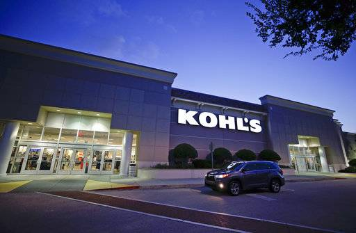 In this Tuesday, Aug. 22, 2017, photo, a car drives by the entrance of a Kohl's department store in Orlando, Fla. Kohl's Corp. reports earnings Thursday, Nov. 9, 2017.