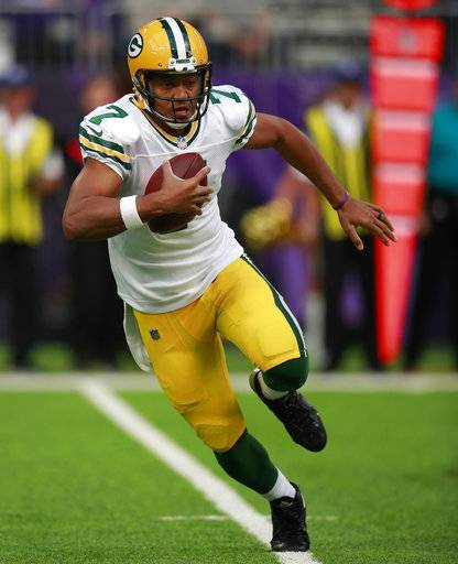 FILE - In this Oct. 15, 2017, file photo, Green Bay Packers quarterback Brett Hundley (7) runs the ball against the Minnesota Vikings during an NFL football game, in Minneapolis. While the Packers come into Sunday's game trying to find their footing with the superstar quarterback sidelined, the Bears are playing more like a respectable team. (Jeff Haynes/File)