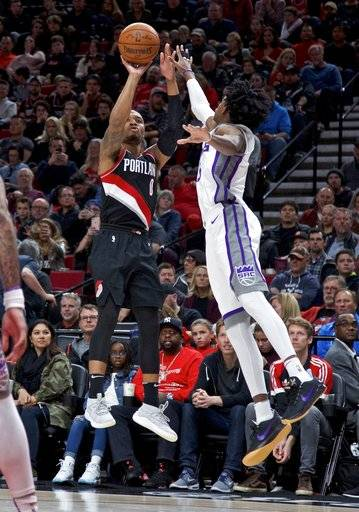 Portland Trail Blazers guard Damian Lillard shoots over Sacramento Kings guard De'Aaron Fox during the second half of an NBA basketball game in Portland, Ore., Saturday, Nov. 18, 2017.