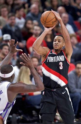 Portland Trail Blazers guard CJ McCollum, right, shoots over Sacramento Kings forward Zach Randolph during the second half of an NBA basketball game in Portland, Ore., Saturday, Nov. 18, 2017.