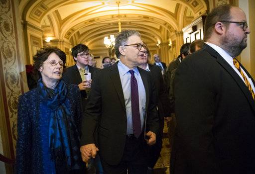 Sen. Al Franken, D-Minn., his wife Franni Bryson, arrives at the Senate to make a statement on charges of sexual misconduct, on Capitol Hill in Washington, Thursday, Dec. 7, 2017.