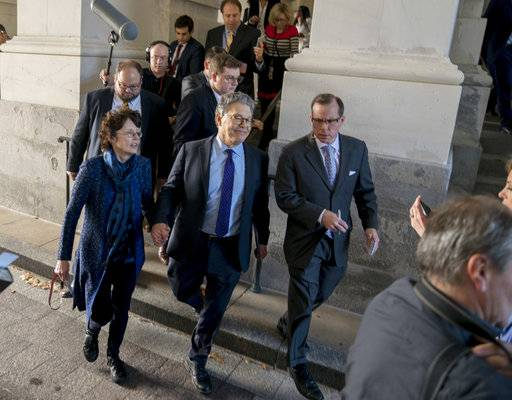 Sen. Al Franken, D-Minn., holds hands with his wife Franni Bryson, center left, as he leaves the Capitol after speaking on the Senate floor, Thursday, Dec. 7, 2017, on Capitol Hill in Washington. Franken said he will resign from the Senate in coming weeks following a wave of sexual misconduct allegations and a collapse of support from his Democratic colleagues, a swift political fall for a once-rising Democratic star.