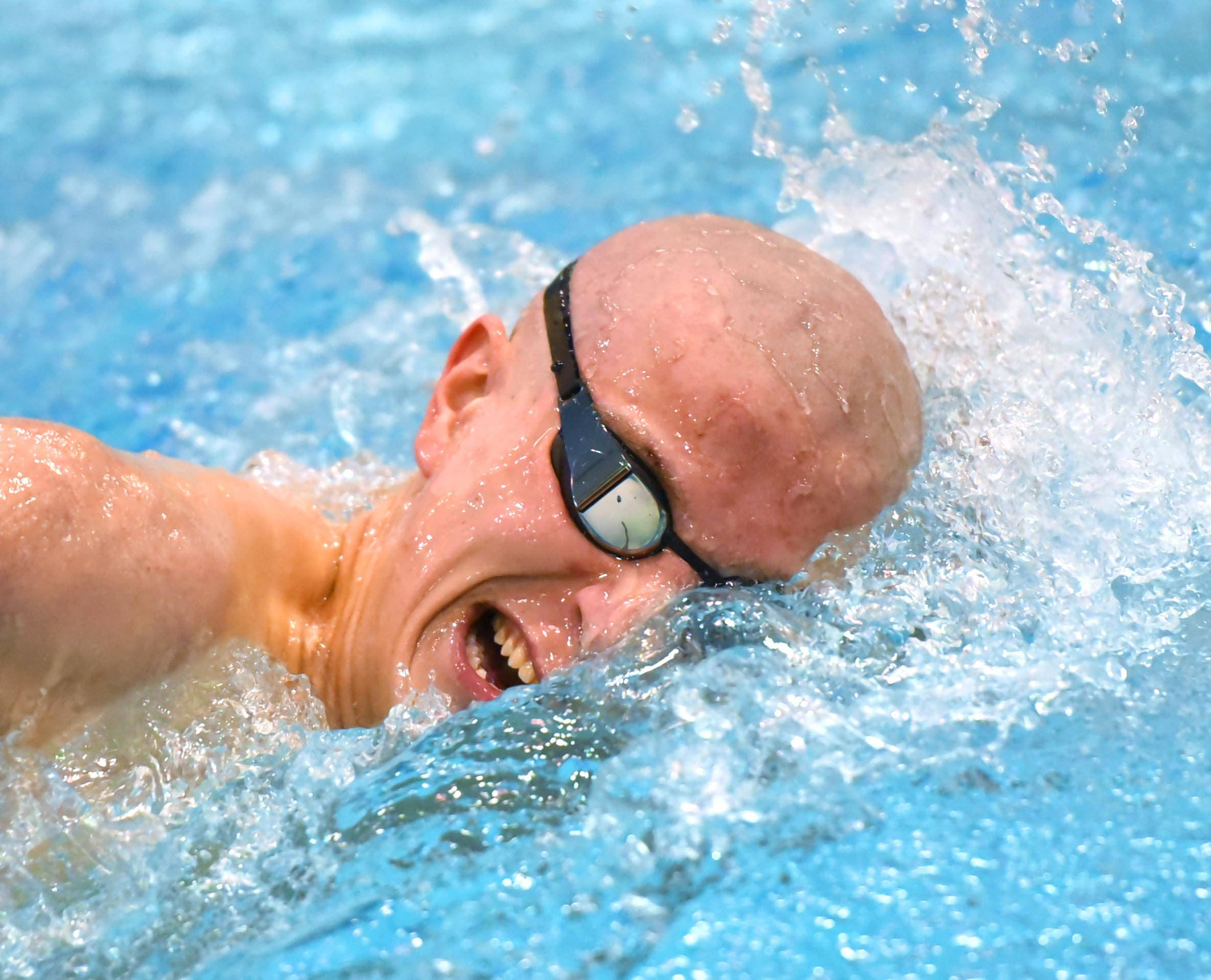 St. Charles East's Austin Cabel competes in the 500-yard freestyle at the boys swimming state meet last season. Cabel returns for the Saints this season.
