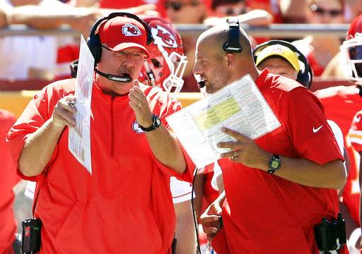 FILE - In this Aug. 13, 2016, file photo, Kansas City Chiefs head coach Andy Reid, left, and co-offensive coordinator Matt Nagy, right, talk during the first half of an NFL preseason football game against the Seattle Seahawks in Kansas City, Mo. Reid turned over some of the playcalling duties to offensive coordinator Matt Nagy last week, and the immediate returns were good. But that wasn't enough for Reid to guarantee Nagy another shot this weekend.