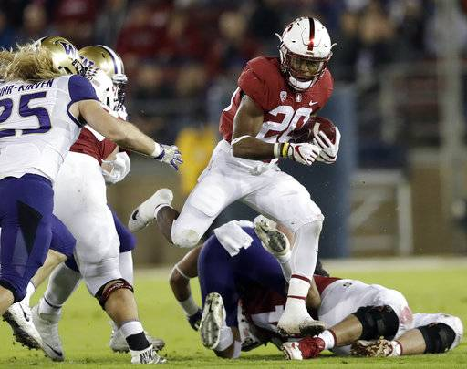 FILE - In this Nov. 10, 2017, file photo, Stanford 's Bryce Love (20) runs against Washington during the first half of an NCAA college football game, in Stanford, Calif. Love was selected to the AP All-Conference Pac-12 team announced Thursday, Dec. 7, 2017.