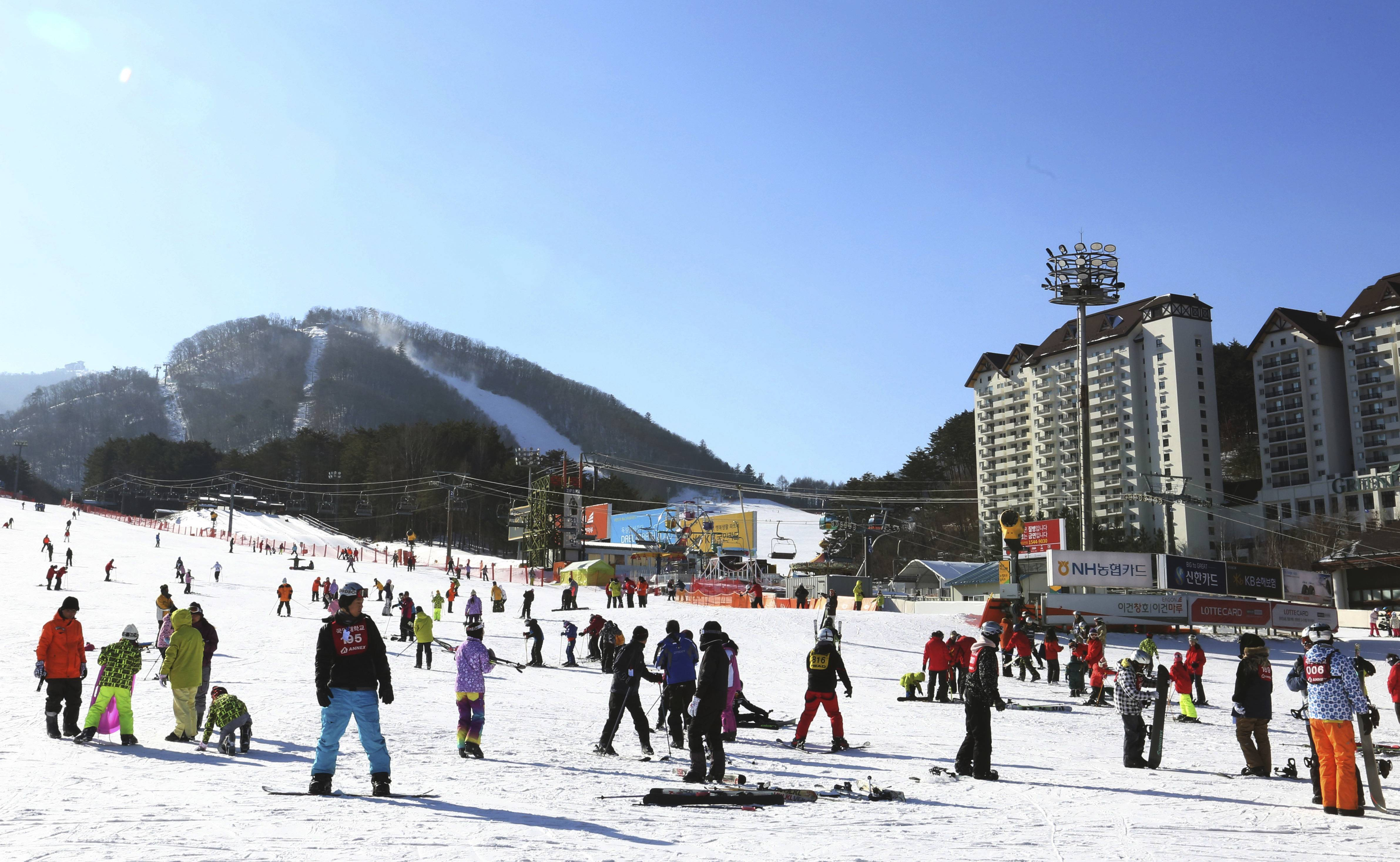 People take to the slopes at Yongpyong Resort in Pyeongchang, South Korea. The Pyeongchang Olympics are coming to a remote, ruggedly beautiful part of South Korea known for icy wind, towering granite mountains and a tough, proud population waiting to welcome foreign hordes.