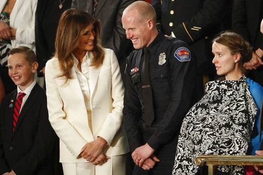 First lady Melania Trump talks with Albuquerque Police Officer Ryan Holets and this wife before the State of the Union address to a joint session of Congress on Capitol Hill in Washington, Tuesday, Jan. 30, 2018.