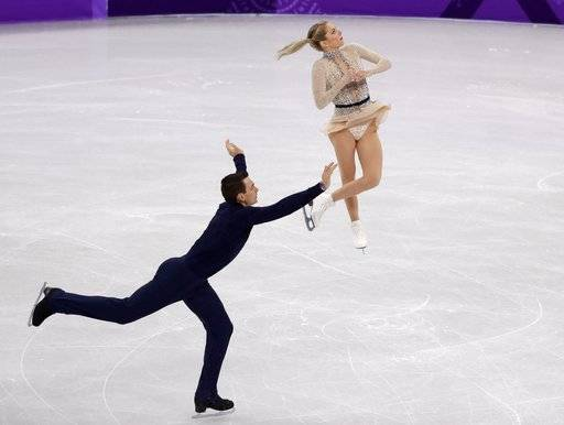Alexa Scimeca Knierim and Chris Knierim of the USA perform in the pair skating short program team event at the 2018 Winter Olympics in Gangneung, South Korea, Friday, Feb. 9, 2018.
