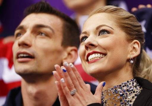 Alexa Scimeca Knierim and Chris Knierim of the USA wait for their scores after performing in the pair skating short program team event at the 2018 Winter Olympics in Gangneung, South Korea, Friday, Feb. 9, 2018.