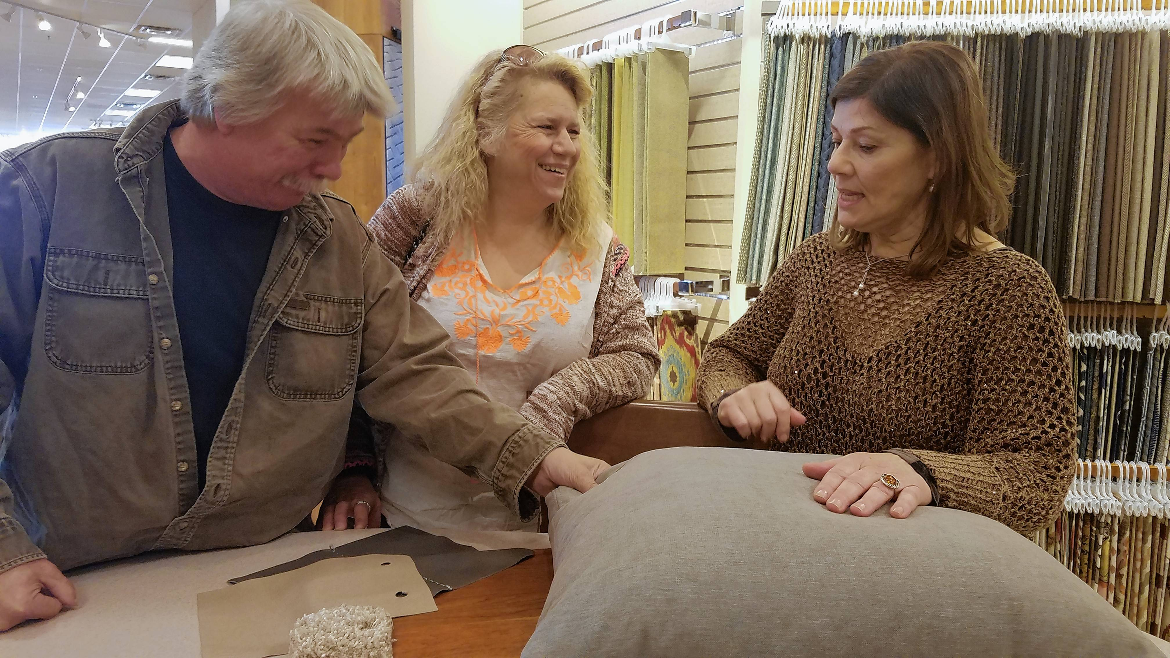 Amy and Harry Walters of Round Lake discuss fabric choices for a sectional with Steinhafels furniture design consultant Andrea Odishoo, right.