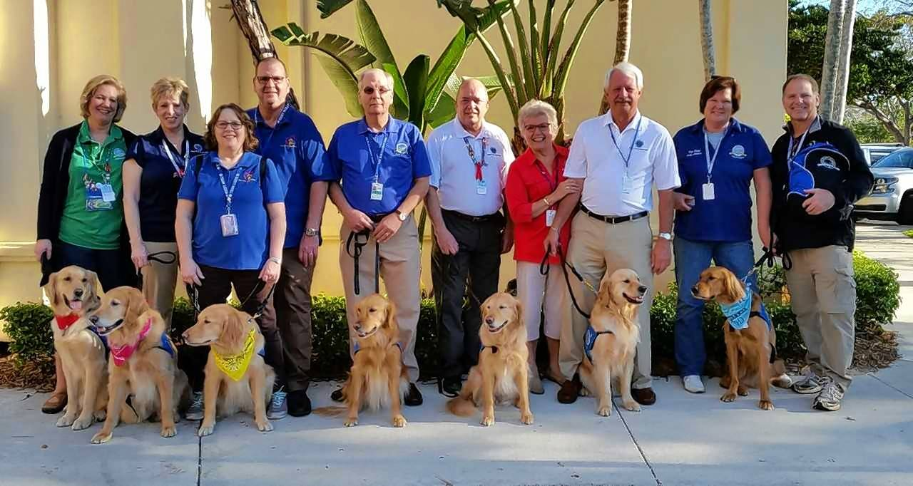 Among the dogs and handlers from Lutheran Church Charities K-9 Ministry who arrived one day after the shootings in Parkland, Florida, are Jenni Hoffmeyer of Grayslake (far left) and her dog, Tobias; Barb Granado of Arlington Heights (second from left) and her dog, Hannah; Rich Martin of Lake Barrington and his dog, Ruthie, center, and Sharon and Mike Flaherty of Prospect Heights with Jacob, just right of Martin.