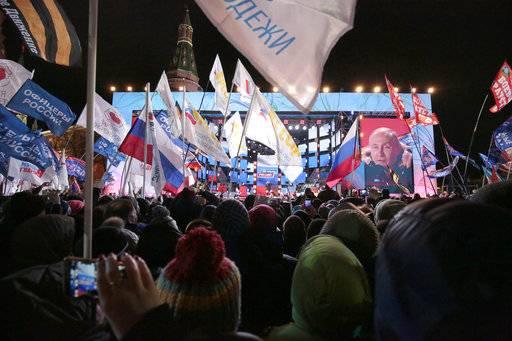 Russian President Vladimir Putin speaks during a rally near the Kremlin in Moscow, Sunday, March 18, 2018. An exit poll suggests that Vladimir Putin has handily won a fourth term as Russia's president, adding six more years in the Kremlin for the man who has led the world's largest country for all of the 21st century.