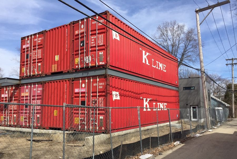 Shipping containers are being used to construct a home on Third Street in St. Charles.