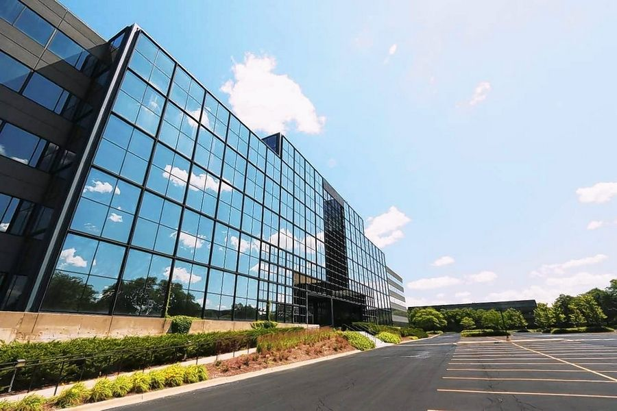 The former OfficeMax headquarters in Naperville has been purchased and will be redeveloped into a multi-tenant office building designed to attract millennials.