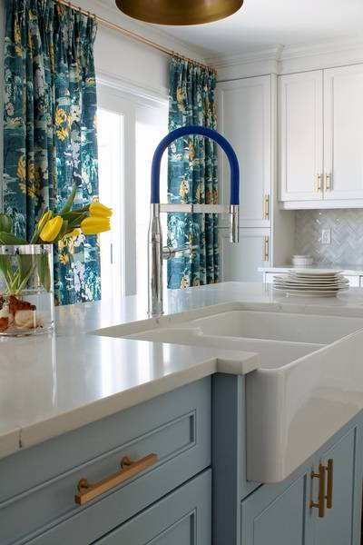 designer christine elliott installed the grohe essence semi pro single handle faucet in this - Blue And White Kitchen