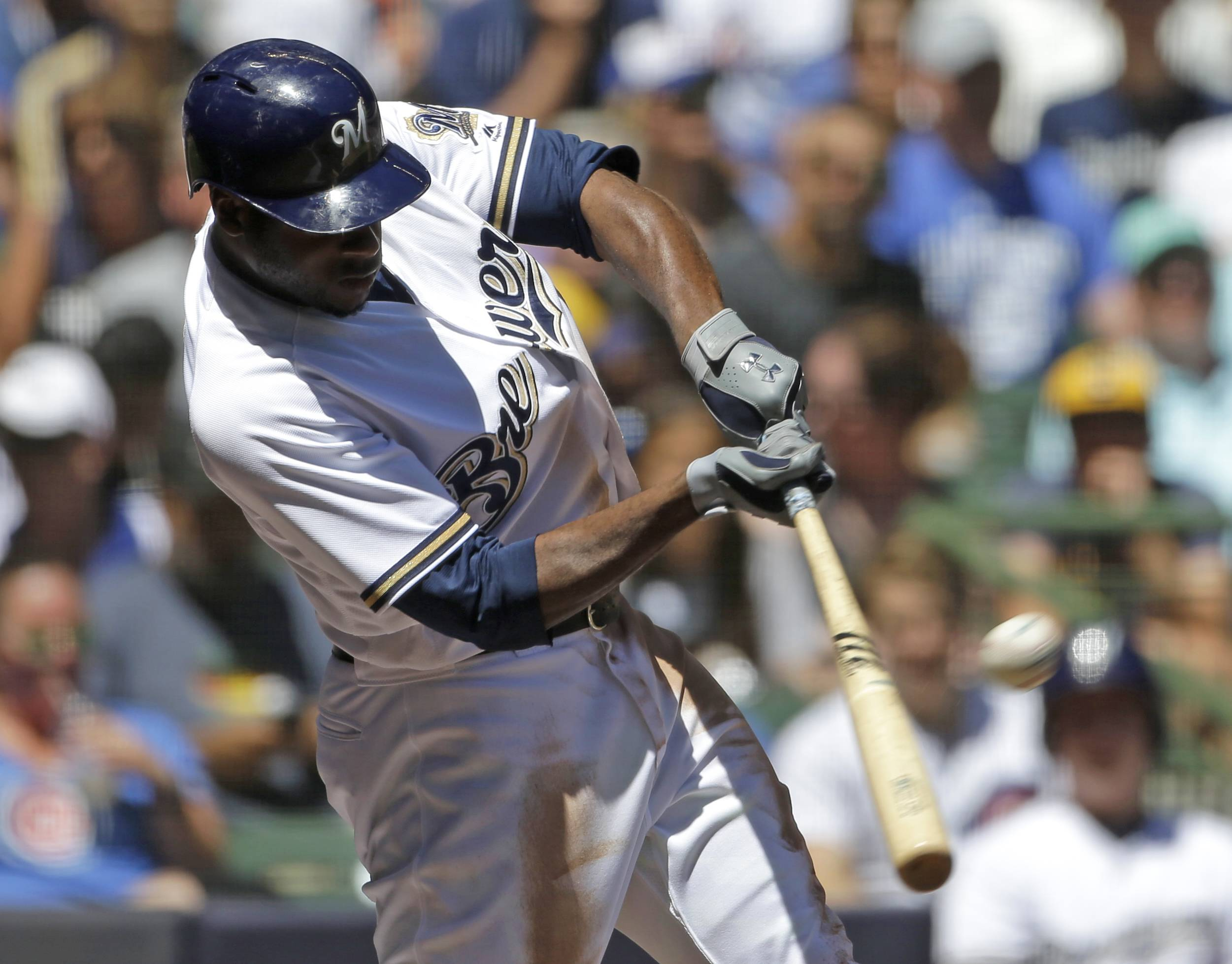 Milwaukee Brewers' Lorenzo Cain hits a solo home run in the third inning Wednesday against the Chicago Cubs at Miller Park.