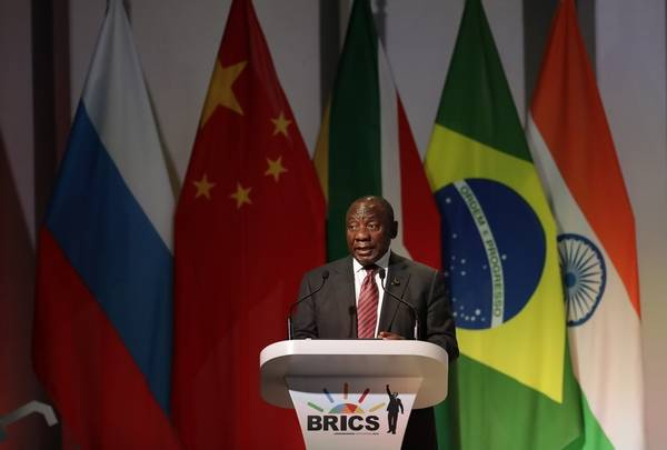 South African President Cyril Ramaphosa speaks during his opening of the BRICS Summit in Johannesburg Wednesday, July 25 2018. The summit runs through Friday with various heads of BRICS attending.