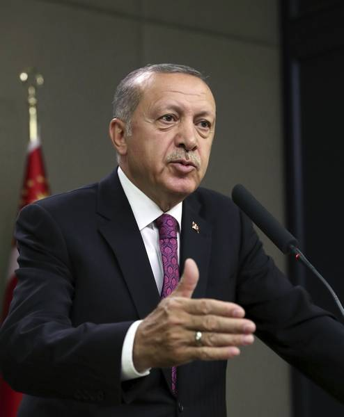 "Turkey's President Recep Tayyip Erdogan speaks to the media in Ankara, Turkey, Wednesday, July 25, 2018, before traveling to South Africa to attend an emerging national economies summit (BRICS). Erdogan has argued against severing economic ties with Iran as the United States readies for sanctions, saying it goes against the independence of states to cut ties with its ""neighbor and strategic partner"" because the U.S. demands it. (Presidential Press Service via AP, Pool)"