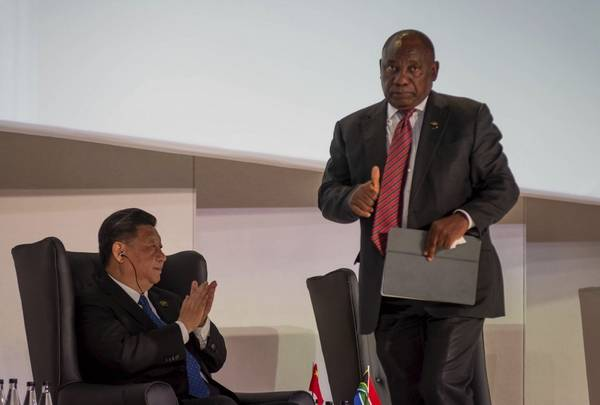 Chinese President Xi Jinping applauds South African President Cyril Ramaphosa, right, at the opening of the BRICS Summit in Johannesburg Wednesday, July 25 2018. The summit runs through to Friday with various heads of BRICS attending.