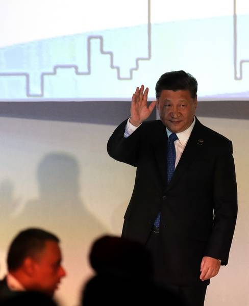 China's President Xi Jinping waves as he leaves the stage after the opening of the BRICS Summit in Johannesburg, South Africa, Wednesday, July 25, 2018. The summit runs through Friday with various heads of BRICS attending.