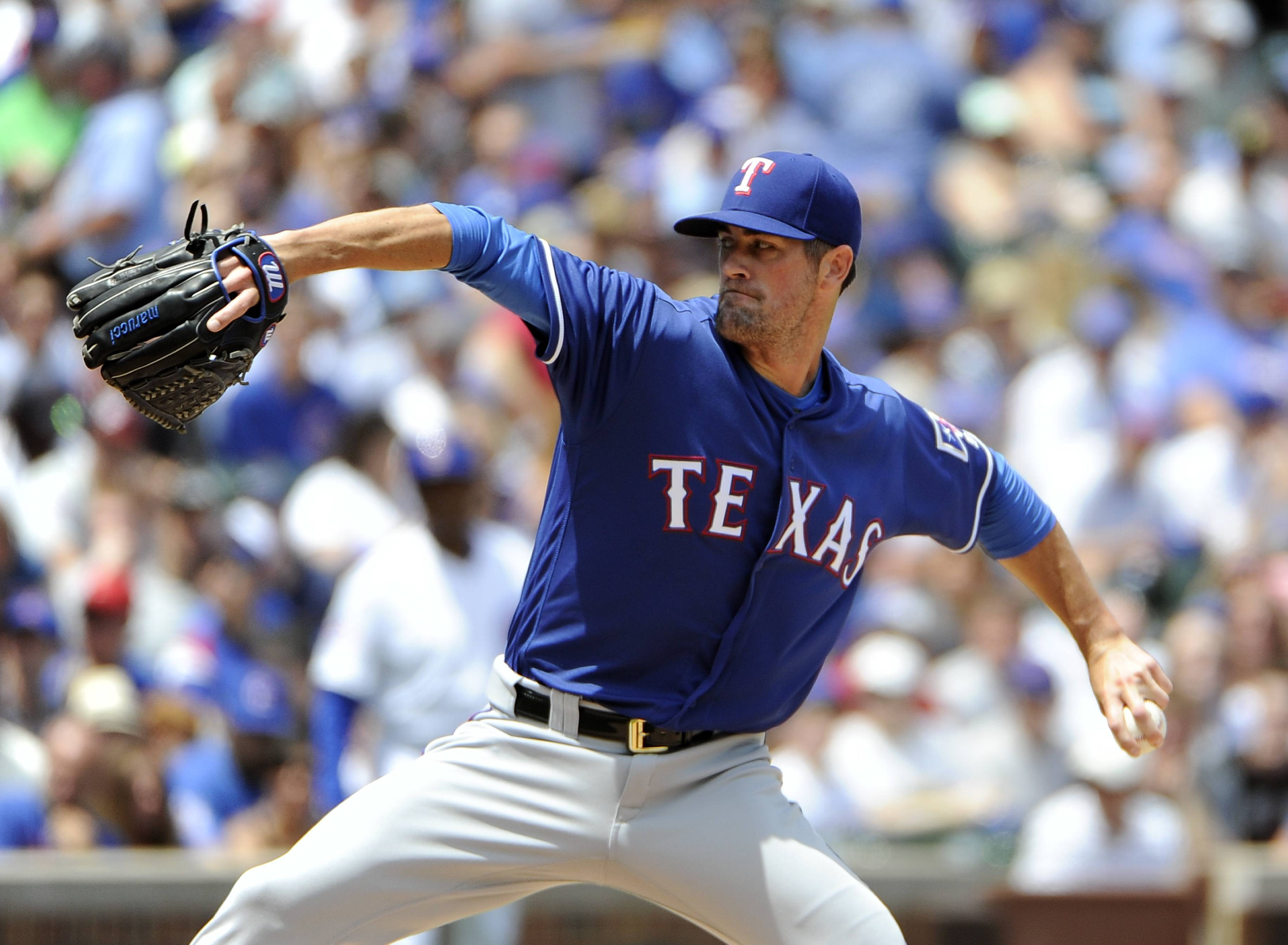 Texas Rangers starting pitcher Cole Hamels (35) throws against the Chicago Cubs during the first inning of an interleague baseball game, Sunday, July 17, 2016, in Chicago.