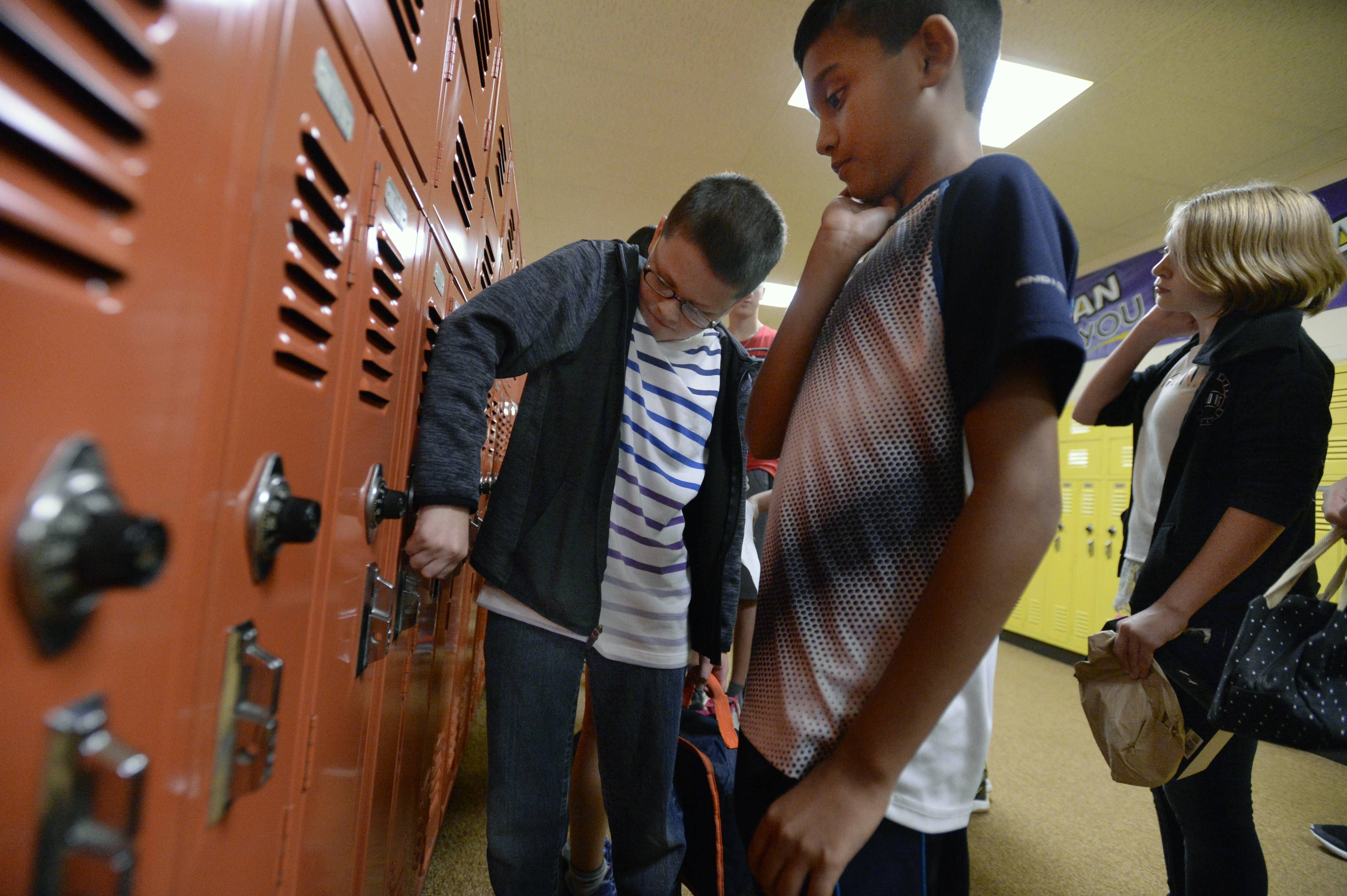 The first day at Mead Junior High in Elk Grove Village Monday brings on life's little problems, like a stuck locker, as Jack Jambrone, 12, helps out fellow seventh-grader Krishan Desai, 12.