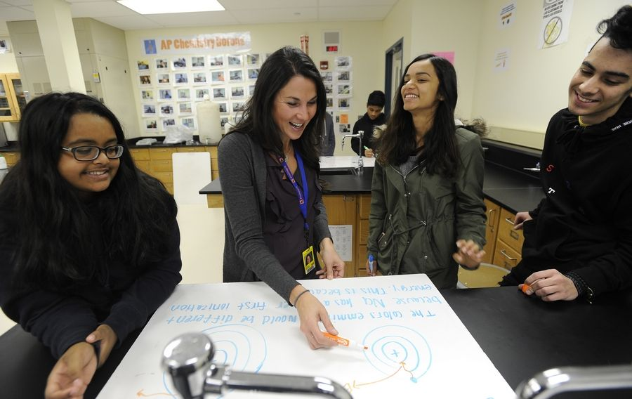 Sierra Mathias, 17, looks on as teacher Darcy Sowle explains the direction the course will take in AP chemistry with Manushi Shah, 17, and Amir Bahari, 18, at Hoffman Estates High School. Helping students earn college credit through Advanced Placement classes is one way high schools get them college and career ready.