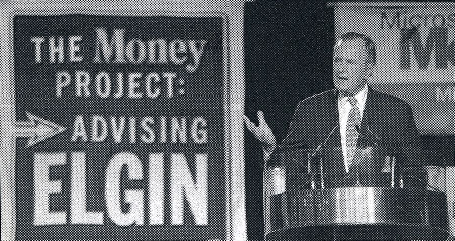 Former President George H.W. Bush addresses a crowd of 5,300 at Elgin High School on Jan. 29, 1997, to kick off a yearlong effort by Money magazine to raise the financial IQ of Elgin residents.
